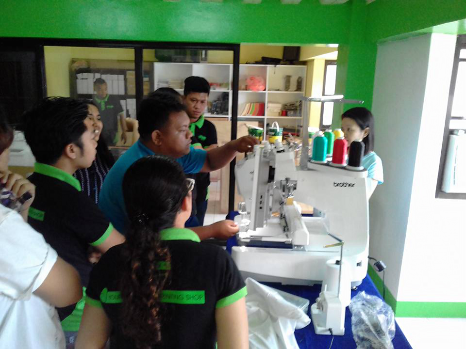 KCEI Specialist demonstrating an embroidery machine for clients