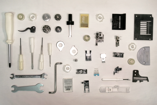 Sewing Machine spare parts laid out on a table